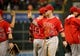 Apr 5, 2014; Houston, TX, USA; Los Angeles Angels left fielder Josh Hamilton (32) high-fives teammates following the end of the game against the Houston Astros at Minute Maid Park. Mandatory Credit: Andrew Richardson-USA TODAY Sports
