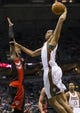 Apr 5, 2014; Milwaukee, WI, USA; Milwaukee Bucks center John Henson (31) dunks the ball during the third quarter against the Toronto Raptors at BMO Harris Bradley Center. Mandatory Credit: Jeff Hanisch-USA TODAY Sports