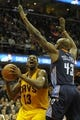 Apr 5, 2014; Cleveland, OH, USA; Cleveland Cavaliers forward Tristan Thompson (13) prepares to shoot the ball as Charlotte Bobcats forward Anthony Tolliver (43) defends in the fourth quarter at Quicken Loans Arena. Mandatory Credit: David Richard-USA TODAY Sports