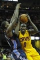 Apr 5, 2014; Cleveland, OH, USA; Cleveland Cavaliers forward Luol Deng (9) dribbles the ball as Charlotte Bobcats forward Michael Kidd-Gilchrist (14) defends in the third quarter at Quicken Loans Arena. Mandatory Credit: David Richard-USA TODAY Sports