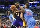 April 6, 2014; Los Angeles, CA, USA; Los Angeles Lakers forward Jordan Hill (27) moves the ball against Los Angeles Clippers forward Blake Griffin (32) during the first half at Staples Center. Mandatory Credit: Gary A. Vasquez-USA TODAY Sports