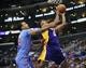 April 6, 2014; Los Angeles, CA, USA; Los Angeles Lakers forward Nick Young (0) moves to the basket against the defense of Los Angeles Clippers forward Matt Barnes (22) during the first half at Staples Center. Mandatory Credit: Gary A. Vasquez-USA TODAY Sports