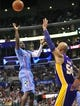 April 6, 2014; Los Angeles, CA, USA; Los Angeles Clippers guard Darren Collison (2) shoots against the defense of Los Angeles Lakers center Robert Sacre (50)stad during the second half at Staples Center. Mandatory Credit: Gary A. Vasquez-USA TODAY Sports