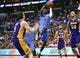 April 6, 2014; Los Angeles, CA, USA; Los Angeles Clippers guard Darren Collison (2) moves to the basket against Los Angeles Lakers center Robert Sacre (50) and forward Ryan Kelly (4) during the second half at Staples Center. Mandatory Credit: Gary A. Vasquez-USA TODAY Sports