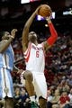 Apr 6, 2014; Houston, TX, USA; Houston Rockets forward Terrence Jones (6) shoots the ball during the second quarter against the Denver Nuggets at Toyota Center. Mandatory Credit: Andrew Richardson-USA TODAY Sports