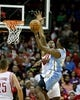 Apr 6, 2014; Houston, TX, USA; Denver Nuggets forward Kenneth Faried (35) shoots the ball over Houston Rockets forward Terrence Jones (6) during the second quarter at Toyota Center. Mandatory Credit: Andrew Richardson-USA TODAY Sports