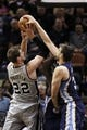 Apr 6, 2014; San Antonio, TX, USA; San Antonio Spurs forward Tiago Splitter (22) gets fouled while shooting against Memphis Grizzlies center Marc Gasol (right) during the second half at AT&T Center. The Spurs won 112-92. Mandatory Credit: Soobum Im-USA TODAY Sports