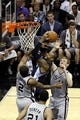 Apr 6, 2014; San Antonio, TX, USA; Memphis Grizzlies forward James Johnson (3) shoots as San Antonio Spurs forward Kawhi Leonard (2)  defends during the second half at AT&T Center. The Spurs won 112-92. Mandatory Credit: Soobum Im-USA TODAY Sports