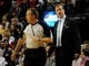 Apr 6, 2014; Portland, OR, USA; Portland Trail Blazers head coach Terry Stotts has some words with referee Bill Spooner (22) during the first quarter at Moda Center. Mandatory Credit: Steve Dykes-USA TODAY Sports