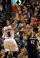 Apr 6, 2014; Portland, OR, USA; Portland Trail Blazers guard Damian Lillard (0) shoots over New Orleans Pelicans center Alexis Ajinca (42) during the first quarter at Moda Center. Mandatory Credit: Steve Dykes-USA TODAY Sports