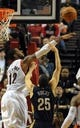 Apr 6, 2014; Portland, OR, USA; Portland Trail Blazers forward LaMarcus Aldridge (12) blocks the shot of New Orleans Pelicans guard Austin Rivers (25) during the fourth quarter of the game at the Moda Center. The Blazers won the game 100-94. Mandatory Credit: Steve Dykes-USA TODAY Sports