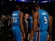 Apr 6, 2014; Phoenix, AZ, USA; Oklahoma City Thunder head coach Scott Brooks (center) in the huddle with his players prior to the game against the Phoenix Suns at US Airways Center. The Suns defeated the Thunder 122-115. Mandatory Credit: Mark J. Rebilas-USA TODAY Sports