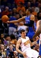 Apr 6, 2014; Phoenix, AZ, USA; Oklahoma City Thunder guard Russell Westbrook (top) drives to the basket above Phoenix Suns guard Goran Dragic in the second half at US Airways Center. The Suns defeated the Thunder 122-115. Mandatory Credit: Mark J. Rebilas-USA TODAY Sports