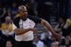 April 4, 2014; Oakland, CA, USA; NBA referee Tom Washington (49) signals during the second quarter between the Golden State Warriors and the Sacramento Kings at Oracle Arena. The Warriors defeated the Kings 102-69. Mandatory Credit: Kyle Terada-USA TODAY Sports