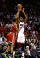 Apr 2, 2014; Miami, FL, USA; Miami Heat forward James Jones (22) takes a three point shot over Milwaukee Bucks guard Ramon Sessions (13) in the second half at American Airlines Arena. The Heat won 96-77.  Mandatory Credit: Robert Mayer-USA TODAY Sports