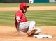 Apr 7, 2014; Houston, TX, USA; Los Angeles Angels third baseman Ian Stewart (44) slides into third base for a triple during the sixth inning against the Houston Astros at Minute Maid Park. Mandatory Credit: Andrew Richardson-USA TODAY Sports
