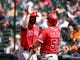 Apr 7, 2014; Houston, TX, USA; Los Angeles Angels third baseman Ian Stewart (44) high-fives right fielder Kole Calhoun (56) after scoring a run during the sixth inning against the Houston Astros at Minute Maid Park. Mandatory Credit: Andrew Richardson-USA TODAY Sports