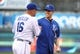 Apr 8, 2014; Kansas City, MO, USA; NASCAR driver Carl Edwards (right) talks with Kansas City Royals designated hitter Billy Butler (16) after throwing out the first pitch before the game with the Tampa Bay Rays at Kauffman Stadium. Mandatory Credit: John Rieger-USA TODAY Sports