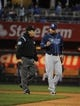 Apr 8, 2014; Kansas City, MO, USA; Tampa Bay Rays second baseman Ben Zobrist (18) talks to second base Umpire Phil Cuzzi (10) about a call against the Kansas City Royals in the third inning at Kauffman Stadium. Mandatory Credit: John Rieger-USA TODAY Sports
