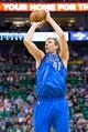 Apr 8, 2014; Salt Lake City, UT, USA; Dallas Mavericks forward Dirk Nowitzki (41) shoots during the first quarter against the Utah Jazz at EnergySolutions Arena. Mandatory Credit: Russ Isabella-USA TODAY Sports