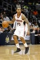 Apr 8, 2014; Atlanta, GA, USA; Atlanta Hawks guard Jeff Teague (0) dribbles the ball against the Detroit Pistons in the fourth quarter at Philips Arena. The Pistons defeated the Hawks 102-95. Mandatory Credit: Brett Davis-USA TODAY Sports