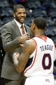 Apr 8, 2014; Atlanta, GA, USA; Detroit Pistons forward Josh Smith (6) talks to Atlanta Hawks guard Jeff Teague (0) after a game at Philips Arena. The Pistons defeated the Hawks 102-95. Mandatory Credit: Brett Davis-USA TODAY Sports