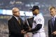 Apr 8, 2014; Seattle, WA, USA; Seattle Mariners general manager Jack Zduriencik presents second baseman Robinson Cano (22) with the Silver Slugger Award prior to the game between the Seattle Mariners and the Los Angeles Angels at Safeco Field. Mandatory Credit: Steven Bisig-USA TODAY Sports