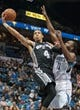 Apr 8, 2014; Minneapolis, MN, USA; San Antonio Spurs guard Danny Green (4) shoots in the third quarter against the Minnesota Timberwolves forward Luc Richard Mbah a Moute (12) at Target Center. The Minnesota Timberwolves win 110-91. Mandatory Credit: Brad Rempel-USA TODAY Sports
