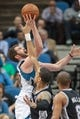 Apr 8, 2014; Minneapolis, MN, USA; Minnesota Timberwolves forward Kevin Love (42) shoots in the third quarter against the San Antonio Spurs at Target Center. The Minnesota Timberwolves win 110-91. Mandatory Credit: Brad Rempel-USA TODAY Sports