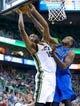Apr 8, 2014; Salt Lake City, UT, USA; Utah Jazz center Derrick Favors (15) shoots against Dallas Mavericks center Samuel Dalembert (1) during the second half at EnergySolutions Arena. The Mavericks won 95-83. Mandatory Credit: Russ Isabella-USA TODAY Sports