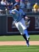 Apr 9, 2014; Kansas City, MO, USA; Kansas City Royals shortstop Alcides Escobar (2) makes a throw to first for the final out of the game against the Tampa Bay Rays at Kauffman Stadium. Kansas City won 7-3. Mandatory Credit: Peter G. Aiken-USA TODAY Sports