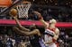 Apr 9, 2014; Washington, DC, USA; Charlotte Bobcats center Al Jefferson (25) scores the game-tying basket as Washington Wizards center Marcin Gortat (4) defends in the final seconds of the fourth quarter at Verizon Center. The Bobcats won 94-88 in overtime. Mandatory Credit: Geoff Burke-USA TODAY Sports