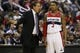 Apr 9, 2014; Washington, DC, USA; Washington Wizards head coach Randy Wittman (L) talks to Wizards guard Bradley Beal (3) against the Charlotte Bobcats in the fourth quarter at Verizon Center. The Bobcats won 94-88 in overtime. Mandatory Credit: Geoff Burke-USA TODAY Sports
