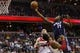 Apr 9, 2014; Washington, DC, USA; Charlotte Bobcats forward Michael Kidd-Gilchrist (14) shoots the ball over Washington Wizards forward Trevor Ariza (1) and Wizards center Marcin Gortat (4) defend in the fourth quarter at Verizon Center. The Bobcats won 94-88 in overtime. Mandatory Credit: Geoff Burke-USA TODAY Sports