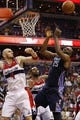 Apr 9, 2014; Washington, DC, USA; Charlotte Bobcats center Al Jefferson (25) and Washington Wizards center Marcin Gortat (4) battle for the ball in the fourth quarter at Verizon Center. The Bobcats won 94-88 in overtime. Mandatory Credit: Geoff Burke-USA TODAY Sports