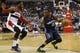 Apr 9, 2014; Washington, DC, USA; Charlotte Bobcats guard Kemba Walker (15) dribbles the ball as Washington Wizards guard John Wall (2) defends in the fourth quarter at Verizon Center. The Bobcats won 94-88 in overtime. Mandatory Credit: Geoff Burke-USA TODAY Sports