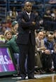 Apr 9, 2014; Milwaukee, WI, USA; Milwaukee Bucks head coach Larry Drew looks on from the sidelines during the fourth quarter against the Indiana Pacers at BMO Harris Bradley Center.  The Pacers won 104-102.  Mandatory Credit: Jeff Hanisch-USA TODAY Sports