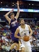 Apr 9, 2014; New Orleans, LA, USA; New Orleans Pelicans center Jeff Withey (5) shoots the ball as Phoenix Suns guard Goran Dragic (1) defends in the second half at the Smoothie King Center. The Suns won 94-88. Mandatory Credit: Crystal LoGiudice-USA TODAY Sports