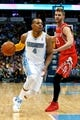Apr 9, 2014; Denver, CO, USA; Denver Nuggets point guard Randy Foye (4) dribbles the ball past Houston Rockets small forward Chandler Parsons (25) in the third quarter at the Pepsi Center. The Nuggets won 123-116. Mandatory Credit: Isaiah J. Downing-USA TODAY Sports