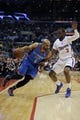 Apr 9, 2014; Los Angeles, CA, USA; Oklahoma City Thunder guard Derek Fisher (6) dribbles the ball as Los Angeles Clippers guard Chris Paul (3) defends during the first quarter at Staples Center. Mandatory Credit: Kelvin Kuo-USA TODAY Sports