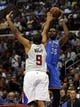Apr 9, 2014; Los Angeles, CA, USA; Oklahoma City Thunder forward Kevin Durant (35) shoots the ball over Los Angeles Clippers guard Jared Dudley (9) during the first quarter at Staples Center. Mandatory Credit: Kelvin Kuo-USA TODAY Sports
