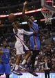 Apr 9, 2014; Los Angeles, CA, USA; Los Angeles Clippers guard Chris Paul (L) shoots the ball as Oklahoma City Thunder forward Serge Ibaka (R) defends during the fourth quarter at Staples Center. The Thunder won 107-101. Mandatory Credit: Kelvin Kuo-USA TODAY Sports