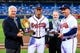 Apr 11, 2014; Atlanta, GA, USA; Atlanta Braves general manager Frank Wren and manager Fredi Gonzalez (33) present shortstop Andrelton Simmons (19) with his 2013 Gold and Platinum Glove awards before the game against the Washington Nationals at Turner Field. Mandatory Credit: Daniel Shirey-USA TODAY Sports