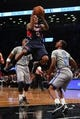 Apr 11, 2014; Brooklyn, NY, USA; Atlanta Hawks point guard Jeff Teague (0) drives to the basket past Brooklyn Nets point guard Marquis Teague (12) during the second quarter of a game at Barclays Center. Mandatory Credit: Brad Penner-USA TODAY Sports