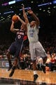 Apr 11, 2014; Brooklyn, NY, USA; Atlanta Hawks point guard Jeff Teague (0) shoots over Brooklyn Nets point guard Marquis Teague (12) during the second quarter of a game at Barclays Center. Mandatory Credit: Brad Penner-USA TODAY Sports