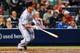 Apr 11, 2014; Atlanta, GA, USA; Washington Nationals shortstop Ian Desmond (20) hits an RBI single in the fourth inning against the Atlanta Braves at Turner Field. Mandatory Credit: Daniel Shirey-USA TODAY Sports