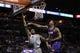 Apr 11, 2014; San Antonio, TX, USA; San Antonio Spurs forward Kawhi Leonard (2) shoots as Phoenix Suns forward Channing Frye (8) defends during the first half at AT&T Center. Mandatory Credit: Soobum Im-USA TODAY Sports