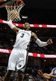 Apr 11, 2014; Memphis, TN, USA; Memphis Grizzlies forward James Johnson (3) dunks the ball against the Philadelphia 76ers at FedExForum. Mandatory Credit: Justin Ford-USA TODAY Sports