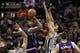 Apr 11, 2014; San Antonio, TX, USA; Phoenix Suns  forward Markieff Morris (11) shoots the ball over San Antonio Spurs forward Jeff Ayres (11) during the first half at AT&T Center. Mandatory Credit: Soobum Im-USA TODAY Sports