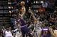 Apr 11, 2014; San Antonio, TX, USA; Phoenix Suns forward Markieff Morris (11) shoots the ball over San Antonio Spurs forward Boris Diaw (33) during the first half at AT&T Center. Mandatory Credit: Soobum Im-USA TODAY Sports